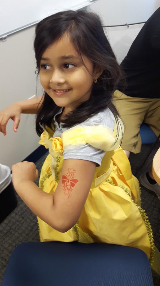 Little-Girl-Airbrush-Tattoo-At-Arm.jpg