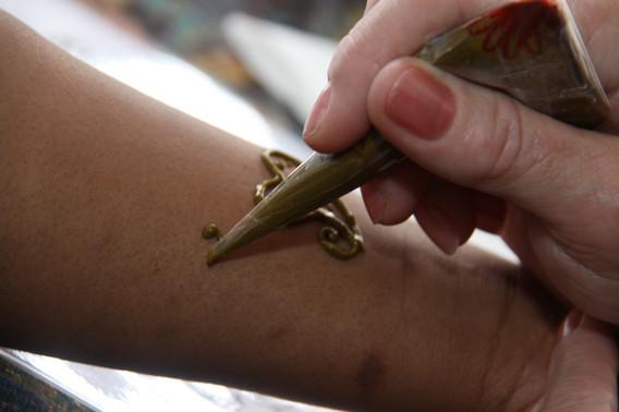 Tattoo-Artist-Doing-Tattoo.jpg