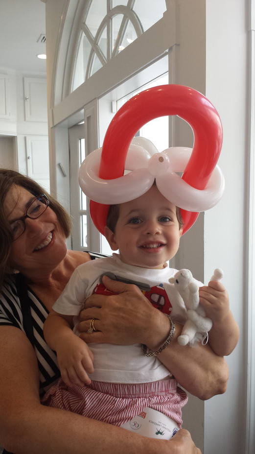 Red-Ping-Hat-Balloon-Twisting-For-Childrens-Party.jpg
