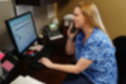 Employee Sarah taking call with a patient.