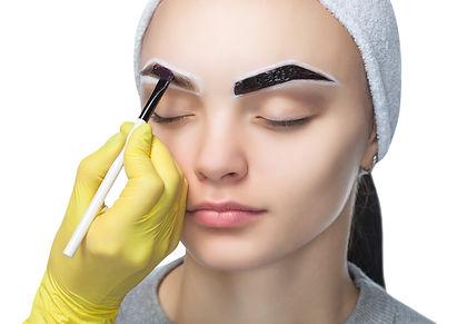 The make-up artist applies a paints eyeb