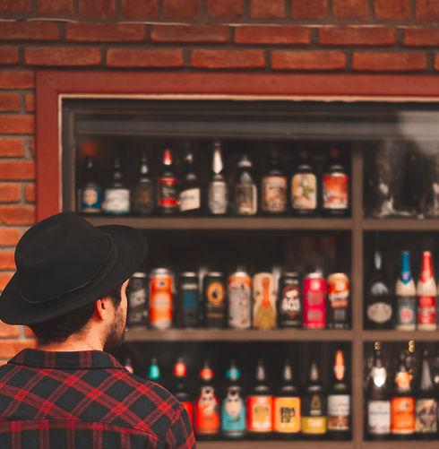 man-looking-at-liquor-bottles-2076748_edited.jpg