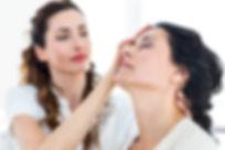 Therapist hypnotizing her patient on white background.jpg