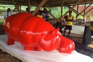 red-hippo-arriving-africa-ninonart_edite