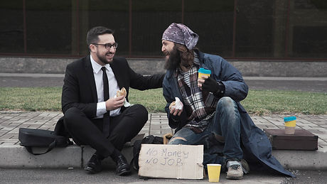 Businessman eating and talking with poor