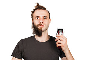 Man with half-shaved beard surprised wit