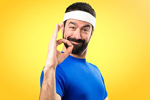 Funny sportsman making OK sign on colorf