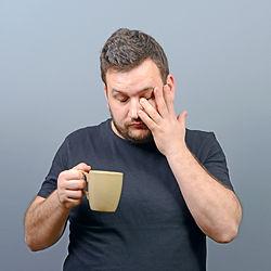 Portrait of tired man having first morni