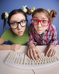 Twin sisters at the computer.jpg