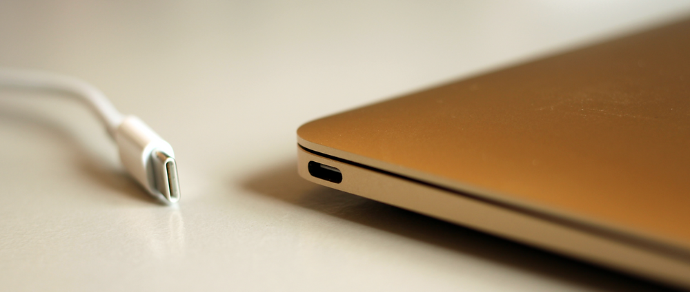 A USB-C cable and corresponding MacBook charging port
