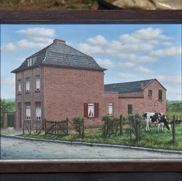 Ouderlijk huis tussen graften