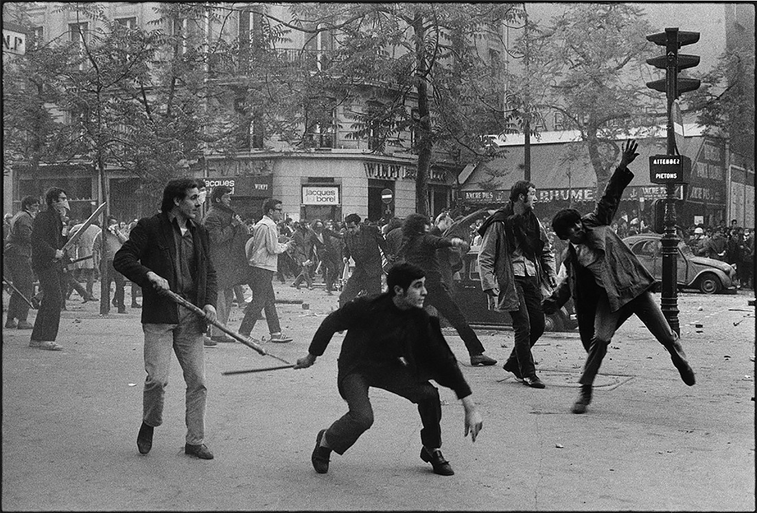 France. Paris. Boulevard Saint Germain. Students hurling projectiles against the police, May 6th 1968 | Bruno Barbey | 1968