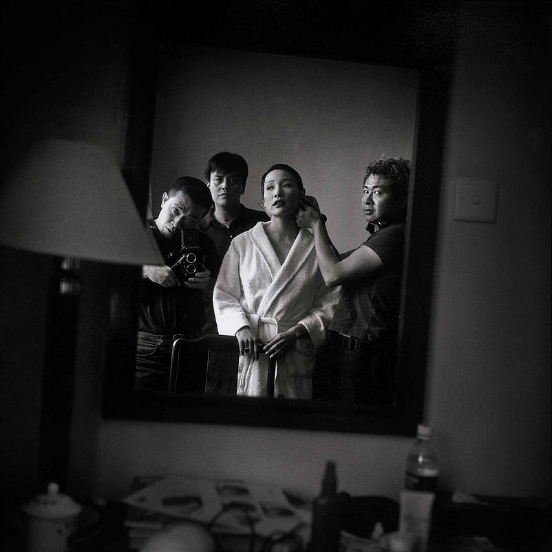 Joan Chen being made up by William Lee, while Sun Zhou and Zhang Haier watching, Longhua Hotel, Shanghai | Zhang Haier | 1999