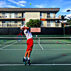 """A very common issue on the serve amongst recreational players is a lack of """"racket drop"""" during their motion. Assuming the proper continental grip is being used, the most common reason for this difficulty is due to a low elbow at this point of the serve. Notice how my elbow is at equal height to my hand and not below it during the back scratch portion of the swing. If you happen to be someone who struggles with the racket drop phase of the swing, get that elbow high immediately after the trophy pose portion of the swing!"""