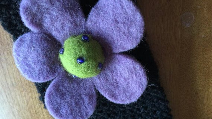 Knitted black headband with purple felted flower