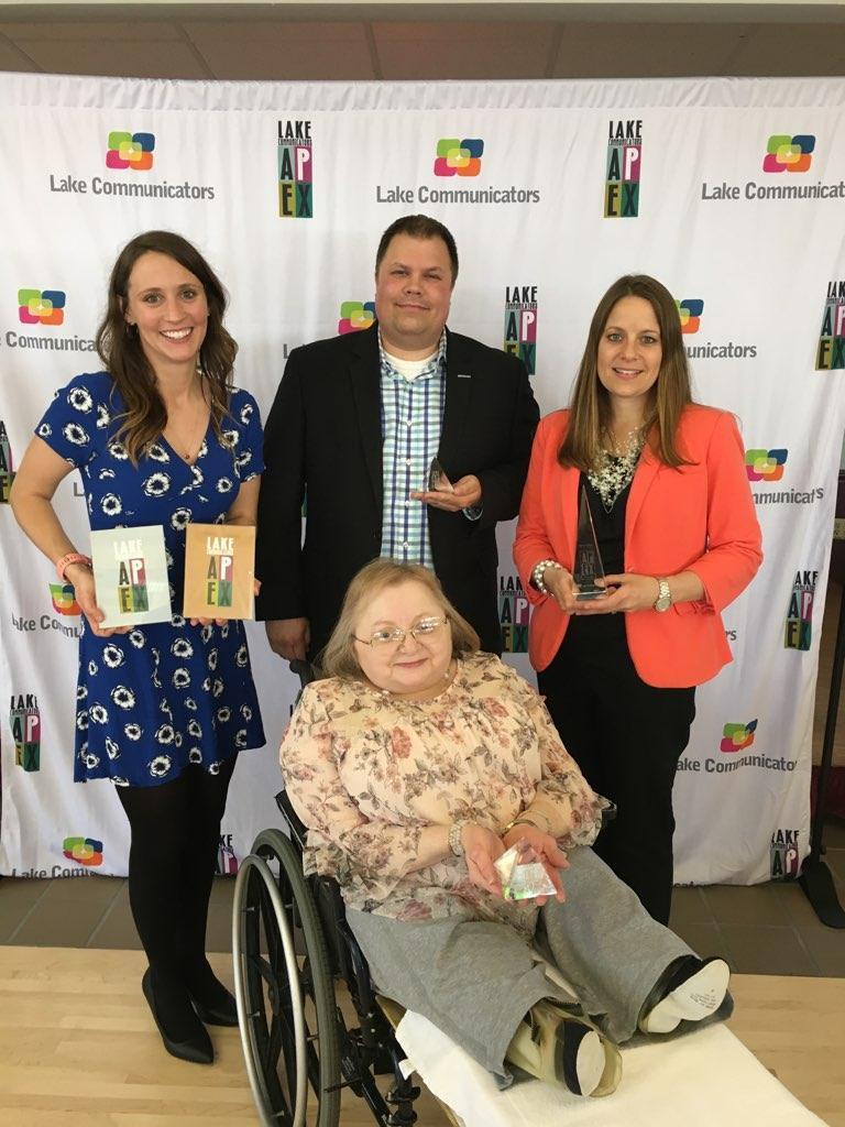 Laketran APEX Awards-Lake Communicator backdrop. L-R: Back:Kerry Jonke, Ben Capelle, Julia Schick Front: Donna McNamee