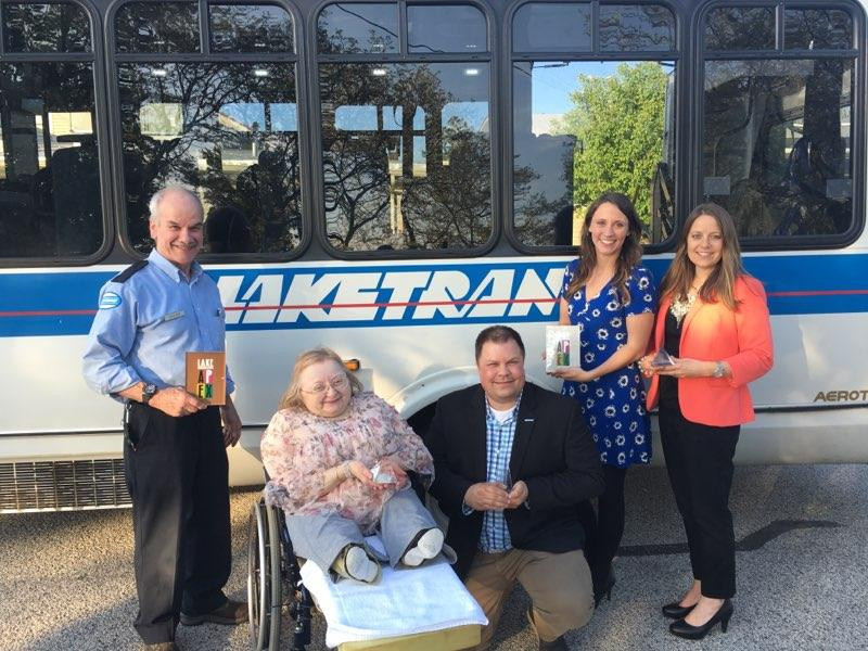 Laketran APEX Awards with bus. L-R Driver Rick Robinson, Trustee Donna McNamme, General Manager Ben Capelle, Communications Specialist Kerry Jonke, Director of Communications Julia Schick