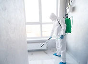 Person in a biohazard clean up suit.