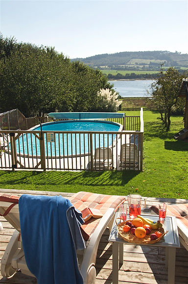 View of pool and estuary from spacious deck