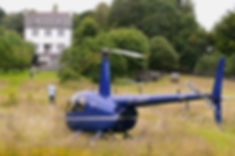 Image of helicopter landed in the garden of Estuary House