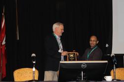 Dr. Doug McElroy Presents Award