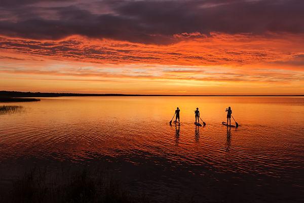 lake sup surfing under amazing dark suns