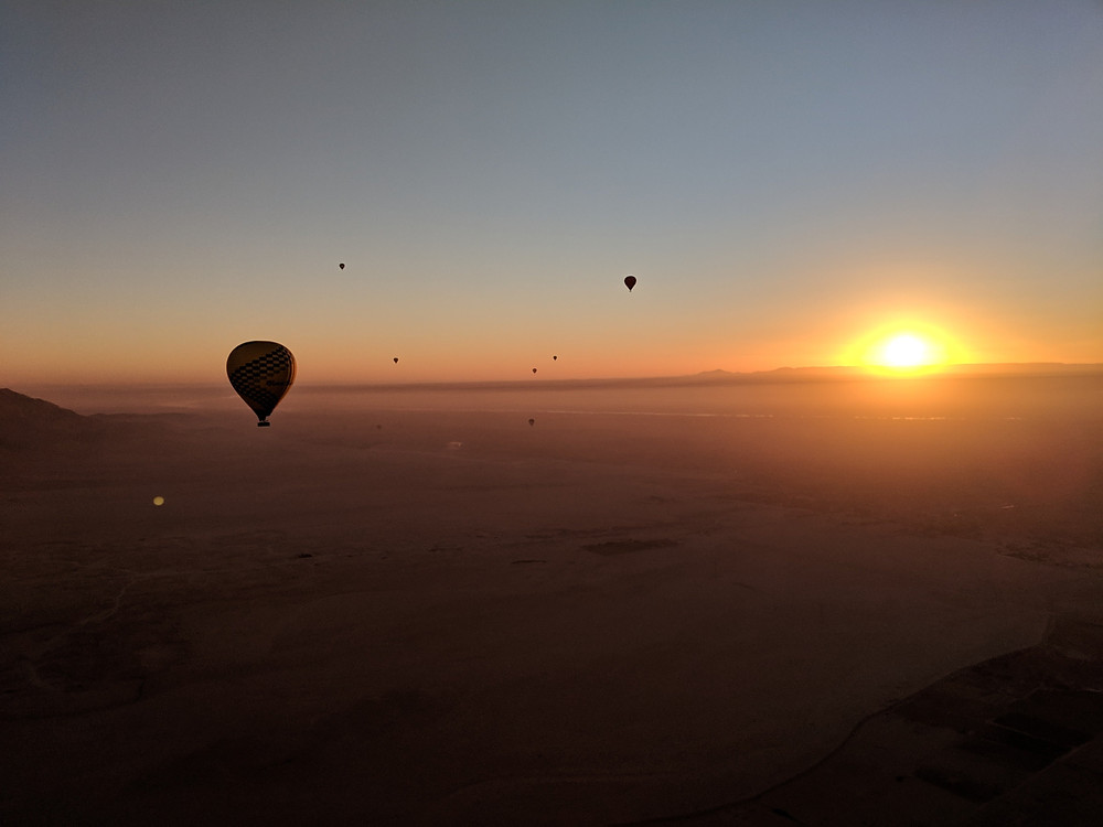 Sunrise balloon ride over the Nile River and adjoining desert.
