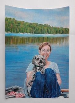Woman and dog on a lake