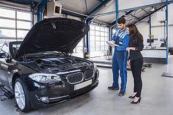 bigstock-Car-mechanic-and-customer-stan-