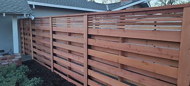 How do you prepare a fence for staining?