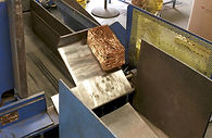 machine creating bricks from metal