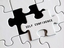 A puzzle piece offset from a puzzle that reads Self Confidence