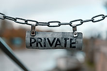 Metal chain sign that says PRIVATE.