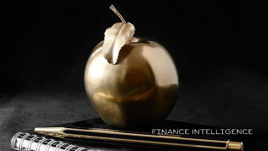 Finance Intelligence gold apple on books