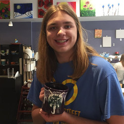 Someone is excited for their new mug! Painted by our talented Jocie for another staff member, Kynan