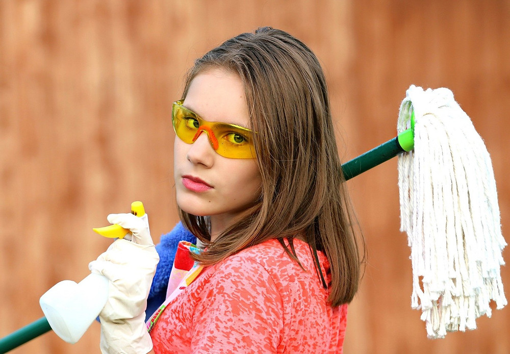 Annoyed Woman with Cleaning Supplies