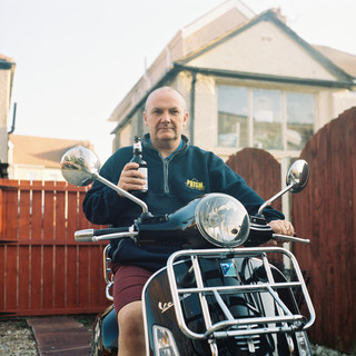my dad, after finishing up work on his Vespa.