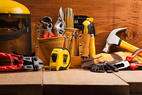 set of working tools on wooden boards.jp