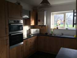 Pippy oak kitchen, plastering and decorating