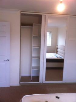 White wardrobe cupboard installation