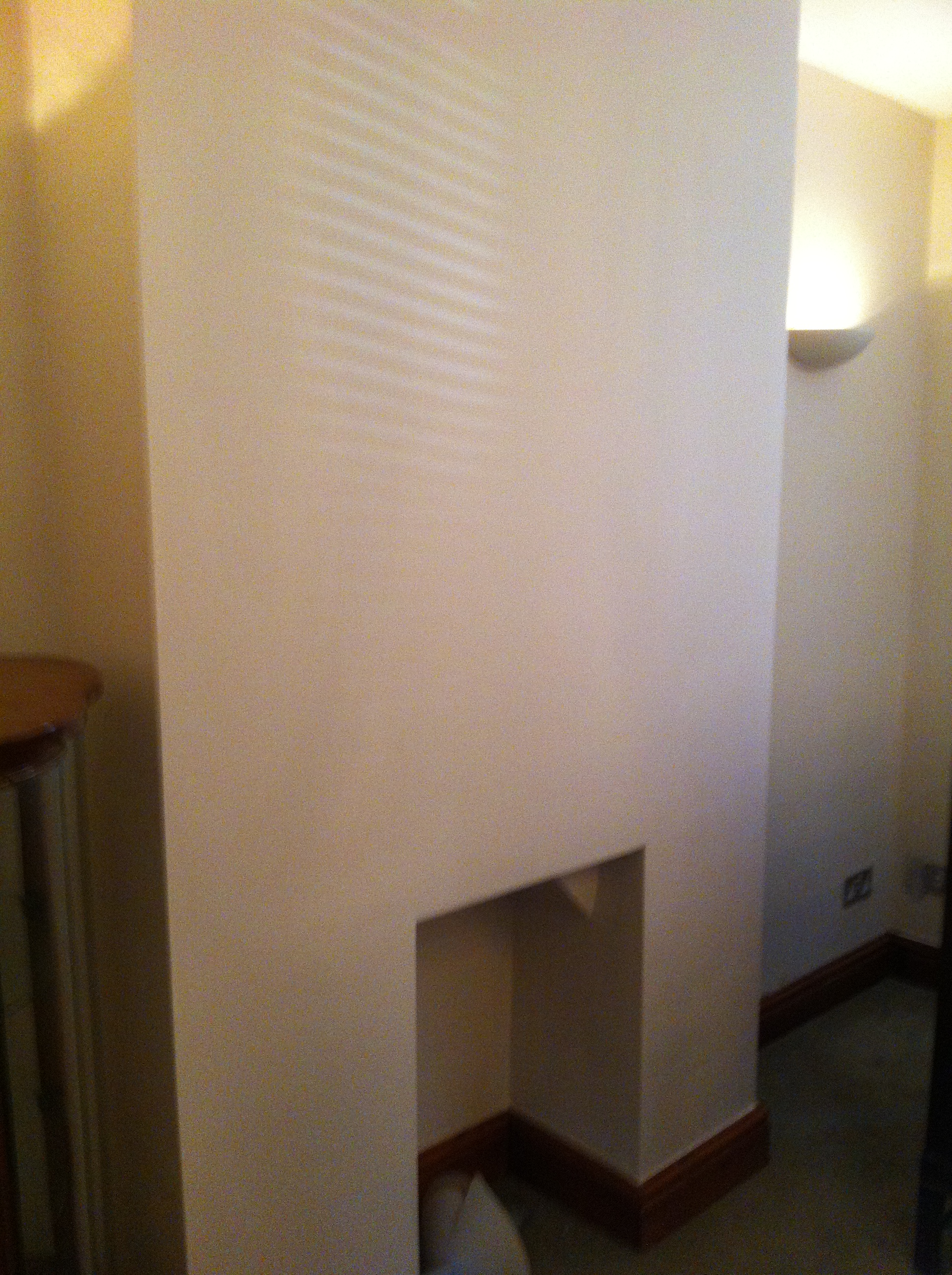 Plastering living fireplace