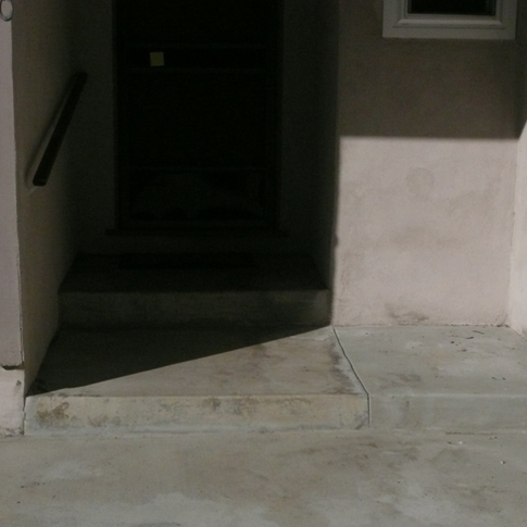 Front door entry to home. Before