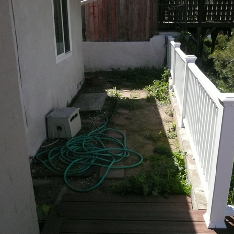 Backyard area directly off deck patio. Before