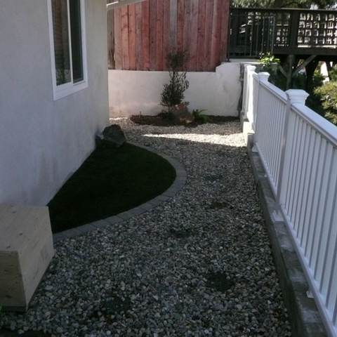Backyard area directly off deck patio. After