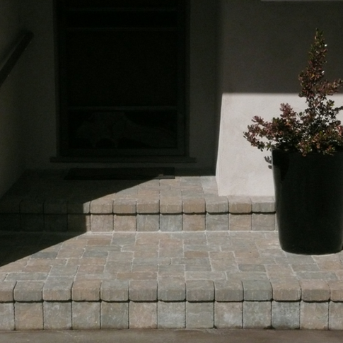 Front door entry to home with pavers. After