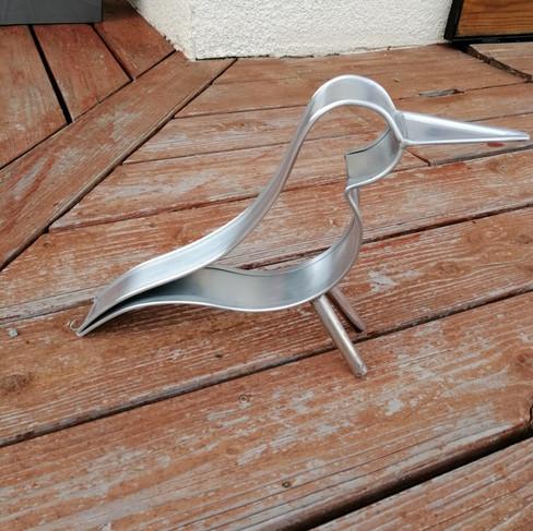 Silhouette d'oiseau en zinc naturel