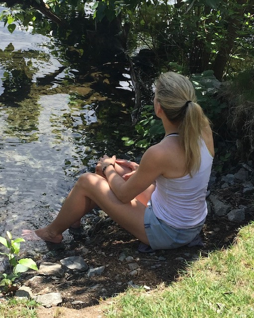 Sitting by a lake