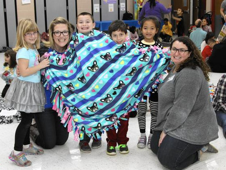 Kids learn about generosity by making pet blankets for shelter animals