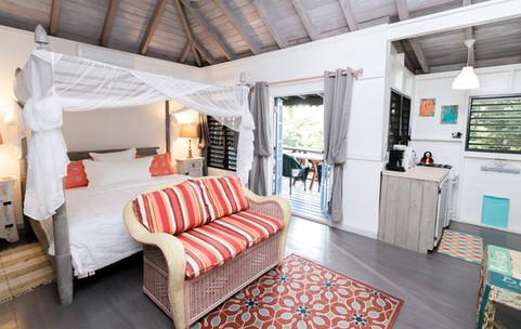 Twinkle king bed, kitchen, balcony door.
