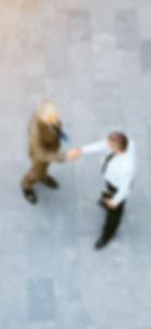 adult-businessmen-standing-in-empty-offi